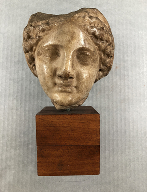 Graeco-Egyptian. <em>Head of a Woman</em>, 2nd century B.C.E. Marble, 5 7/8 x 5 1/16 in. (15 x 12.8 cm). Brooklyn Museum, Gift of Evangeline Wilbour Blashfield, Theodora Wilbour, and Victor Wilbour honoring the wishes of their mother, Charlotte Beebe Wilbour, as a memorial to their father, Charles Edwin Wilbour, 16.580.162. Creative Commons-BY (Photo: , CUR.16.580.162_view01.jpg)