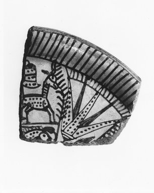 <em>Fragment of Bowl with Lotus, Antelope, and Fish</em>, ca. 1539-1390 B.C.E. Faience, 3 1/8 x 3 1/16 in. (8 x 7.7 cm). Brooklyn Museum, Gift of Evangeline Wilbour Blashfield, Theodora Wilbour, and Victor Wilbour honoring the wishes of their mother, Charlotte Beebe Wilbour, as a memorial to their father Charles Edwin Wilbour, 16.580.176. Creative Commons-BY (Photo: Brooklyn Museum, CUR.16.580.176_NegA_print_bw.jpg)