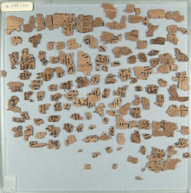 <em>Papyrus Fragments Inscribed in Hieratic</em>, ca. 1938-1630 B.C.E. Papyrus, ink, a: Glass: 12 x 12 in. (30.5 x 30.5 cm). Brooklyn Museum, Gift of Evangeline Wilbour Blashfield, Theodora Wilbour, and Victor Wilbour honoring the wishes of their mother, Charlotte Beebe Wilbour, as a memorial to their father, Charles Edwin Wilbour, 16.580.224a-b (Photo: Brooklyn Museum, CUR.16.580.224a_front_IMLS_PS5.jpg)