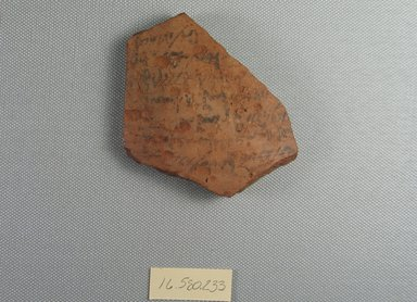 <em>Demotic Ostracon</em>, Year 7 (?) or 8 (?) of Tiberius. Terracotta, pigment, 2 3/4 x 3/8 x 3 1/8 in. (7 x 1 x 8 cm). Brooklyn Museum, Gift of Evangeline Wilbour Blashfield, Theodora Wilbour, and Victor Wilbour honoring the wishes of their mother, Charlotte Beebe Wilbour, as a memorial to their father, Charles Edwin Wilbour, 16.580.233. Creative Commons-BY (Photo: Brooklyn Museum, CUR.16.580.233_view1.jpg)