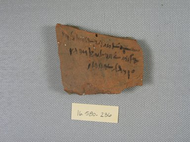 <em>Demotic Ostracon</em>, Year 13 of a Ptolemy. Terracotta, pigment, 2 1/16 x 5/16 x 2 7/16 in. (5.3 x 0.8 x 6.2 cm). Brooklyn Museum, Gift of Evangeline Wilbour Blashfield, Theodora Wilbour, and Victor Wilbour honoring the wishes of their mother, Charlotte Beebe Wilbour, as a memorial to their father, Charles Edwin Wilbour, 16.580.236. Creative Commons-BY (Photo: Brooklyn Museum, CUR.16.580.236_view1.jpg)