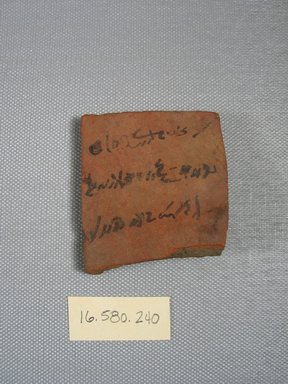 <em>Demotic Ostracon</em>, Year 30 (?) of Augustus. Terracotta, pigment, 2 1/16 x 5/16 x 2 5/16 in. (5.3 x 0.8 x 5.9 cm). Brooklyn Museum, Gift of Evangeline Wilbour Blashfield, Theodora Wilbour, and Victor Wilbour honoring the wishes of their mother, Charlotte Beebe Wilbour, as a memorial to their father, Charles Edwin Wilbour, 16.580.240. Creative Commons-BY (Photo: Brooklyn Museum, CUR.16.580.240_view1.jpg)