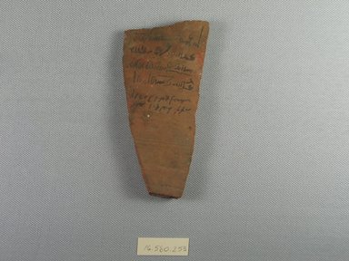 <em>Demotic Ostracon</em>, Year 38 of Augustus. Terracotta, pigment, 2 3/8 x 3/8 x 5 1/8 in. (6.1 x 1 x 13 cm). Brooklyn Museum, Gift of Evangeline Wilbour Blashfield, Theodora Wilbour, and Victor Wilbour honoring the wishes of their mother, Charlotte Beebe Wilbour, as a memorial to their father, Charles Edwin Wilbour, 16.580.253. Creative Commons-BY (Photo: Brooklyn Museum, CUR.16.580.253_view1.jpg)