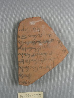 <em>Demotic Ostracon</em>. Terracotta, pigment, 2 7/8 x 3/8 x 3 7/8 in. (7.3 x 1 x 9.9 cm). Brooklyn Museum, Gift of Evangeline Wilbour Blashfield, Theodora Wilbour, and Victor Wilbour honoring the wishes of their mother, Charlotte Beebe Wilbour, as a memorial to their father, Charles Edwin Wilbour, 16.580.255. Creative Commons-BY (Photo: Brooklyn Museum, CUR.16.580.255_view1.jpg)