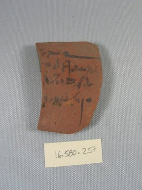 <em>Demotic Ostracon</em>, Year six of a Ptolemy. Terracotta, pigment, 1 7/8 x 5/16 x 2 5/8 in. (4.8 x 0.8 x 6.7 cm). Brooklyn Museum, Gift of Evangeline Wilbour Blashfield, Theodora Wilbour, and Victor Wilbour honoring the wishes of their mother, Charlotte Beebe Wilbour, as a memorial to their father, Charles Edwin Wilbour, 16.580.257. Creative Commons-BY (Photo: Brooklyn Museum, CUR.16.580.257_view1.jpg)