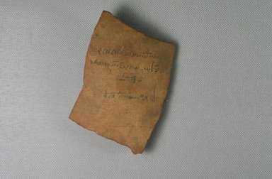 <em>Demotic Ostracon</em>, Year 32 of Augustus. Terracotta, pigment, 3 3/16 x 3/8 x 3 7/8 in. (8.1 x 0.9 x 9.9 cm). Brooklyn Museum, Gift of Evangeline Wilbour Blashfield, Theodora Wilbour, and Victor Wilbour honoring the wishes of their mother, Charlotte Beebe Wilbour, as a memorial to their father, Charles Edwin Wilbour, 16.580.259. Creative Commons-BY (Photo: Brooklyn Museum, CUR.16.580.259_view3.jpg)