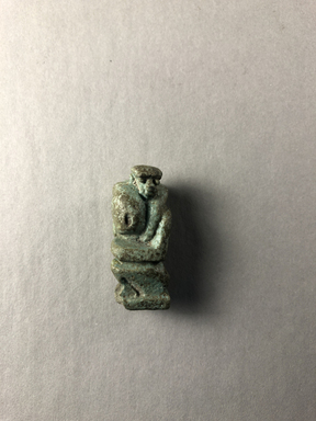 <em>Seated Monkey as Amulet</em>, 30-395 C.E. Faience, 1 5/16 × 9/16 × 9/16 in. (3.4 × 1.4 × 1.5 cm). Brooklyn Museum, Gift of Evangeline Wilbour Blashfield, Theodora Wilbour, and Victor Wilbour honoring the wishes of their mother, Charlotte Beebe Wilbour, as a memorial to their father Charles Edwin Wilbour, 16.580.43. Creative Commons-BY (Photo: , CUR.16.580.43_view01.jpg)