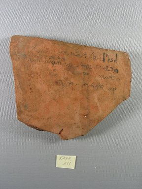 Demotic. <em>Demotic Ostracon</em>, Year 25 of a Ptolemy. Terracotta, pigment, 4 5/8 x 9/16 x 5 11/16 in. (11.8 x 1.4 x 14.5 cm). Brooklyn Museum, Gift of Evangeline Wilbour Blashfield, Theodora Wilbour, and Victor Wilbour honoring the wishes of their mother, Charlotte Beebe Wilbour, as a memorial to their father, Charles Edwin Wilbour, 16.580.488. Creative Commons-BY (Photo: Brooklyn Museum, CUR.16.580.488_view1.jpg)