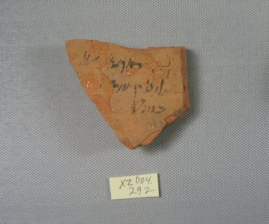 Demotic. <em>Demotic Ostracon</em>, Year 22 (of Ptolemy II Philadelphus?). Terracotta, pigment, 2 7/16 x 1/2 x 2 15/16 in. (6.2 x 1.2 x 7.5 cm). Brooklyn Museum, Gift of Evangeline Wilbour Blashfield, Theodora Wilbour, and Victor Wilbour honoring the wishes of their mother, Charlotte Beebe Wilbour, as a memorial to their father, Charles Edwin Wilbour, 16.580.510. Creative Commons-BY (Photo: Brooklyn Museum, CUR.16.580.510_view1.jpg)