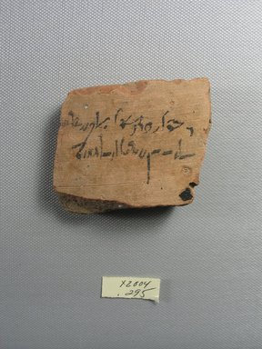 Demotic. <em>Demotic Ostracon</em>, Year 7 (of Ptolemy II Philadelphus?). Terracotta, pigment, 2 5/16 x 1/2 x 2 15/16 in. (5.8 x 1.2 x 7.4 cm). Brooklyn Museum, Gift of Evangeline Wilbour Blashfield, Theodora Wilbour, and Victor Wilbour honoring the wishes of their mother, Charlotte Beebe Wilbour, as a memorial to their father, Charles Edwin Wilbour, 16.580.513. Creative Commons-BY (Photo: Brooklyn Museum, CUR.16.580.513_view1.jpg)