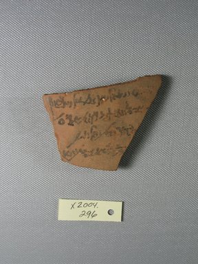 Demotic. <em>Demotic Ostracon</em>, Year 22 of Augustus. Terracotta, pigment, 2 1/16 x 1/4 x 2 15/16 in. (5.3 x 0.7 x 7.4 cm). Brooklyn Museum, Gift of Evangeline Wilbour Blashfield, Theodora Wilbour, and Victor Wilbour honoring the wishes of their mother, Charlotte Beebe Wilbour, as a memorial to their father, Charles Edwin Wilbour, 16.580.514. Creative Commons-BY (Photo: Brooklyn Museum, CUR.16.580.514_view1.jpg)