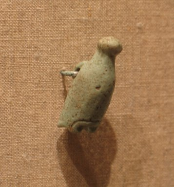 <em>White Crown as Amulet</em>, ca. 664-30 B.C.E. Faience, 1 1/16 x 7/16 in.  (2.7 x 1.1 cm). Brooklyn Museum, Gift of Evangeline Wilbour Blashfield, Theodora Wilbour, and Victor Wilbour honoring the wishes of their mother, Charlotte Beebe Wilbour, as a memorial to their father Charles Edwin Wilbour, 16.580.51. Creative Commons-BY (Photo: Brooklyn Museum, CUR.16.580.51_wwgA-3.jpg)