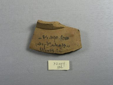 Demotic. <em>Demotic Ostracon</em>, Year 15 (of Ptolemy II Philadelphus?). Terracotta, pigment, 1 3/4 x 1/2 x 2 15/16 in. (4.5 x 1.3 x 7.4 cm). Brooklyn Museum, Gift of Evangeline Wilbour Blashfield, Theodora Wilbour, and Victor Wilbour honoring the wishes of their mother, Charlotte Beebe Wilbour, as a memorial to their father, Charles Edwin Wilbour, 16.580.520. Creative Commons-BY (Photo: Brooklyn Museum, CUR.16.580.520_view1.jpg)