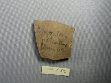 Demotic. <em>Demotic Ostracon</em>, Year 2 (of Ptolemy II Philadelphus?). Terracotta, pigment, 2 3/16 x 3/8 x 2 7/16 in. (5.6 x 1 x 6.2 cm). Brooklyn Museum, Gift of Evangeline Wilbour Blashfield, Theodora Wilbour, and Victor Wilbour honoring the wishes of their mother, Charlotte Beebe Wilbour, as a memorial to their father, Charles Edwin Wilbour, 16.580.521. Creative Commons-BY (Photo: Brooklyn Museum, CUR.16.580.521_view1.jpg)