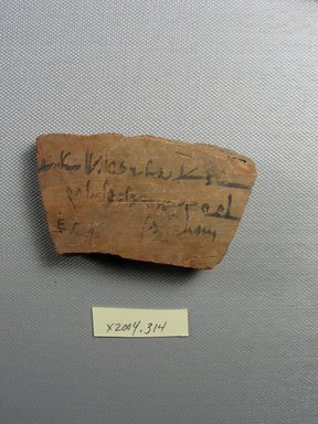 Demotic. <em>Demotic Ostracon</em>, Year 19 (of Ptolemy II Philadelphus?). Terracotta, pigment, 1 13/16 x 3/8 x 3 1/4 in. (4.6 x 1 x 8.3 cm). Brooklyn Museum, Gift of Evangeline Wilbour Blashfield, Theodora Wilbour, and Victor Wilbour honoring the wishes of their mother, Charlotte Beebe Wilbour, as a memorial to their father, Charles Edwin Wilbour, 16.580.531. Creative Commons-BY (Photo: Brooklyn Museum, CUR.16.580.531_view1.jpg)