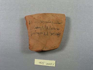 Demotic. <em>Demotic Ostracon</em>, Year 34 (of Ptolemy II Philadelphus). Terracotta, pigment, 3 1/4 x 3/8 x 3 7/16 in. (8.2 x 0.9 x 8.7 cm). Brooklyn Museum, Gift of Evangeline Wilbour Blashfield, Theodora Wilbour, and Victor Wilbour honoring the wishes of their mother, Charlotte Beebe Wilbour, as a memorial to their father, Charles Edwin Wilbour, 16.580.533. Creative Commons-BY (Photo: Brooklyn Museum, CUR.16.580.533_view1.jpg)