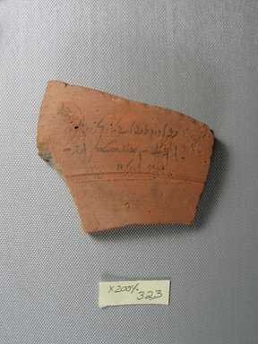 Demotic. <em>Demotic Ostracon</em>, Year 37 (of Ptolemy II Philadelphus). Terracotta, pigment, 3 1/8 x 1/2 x 3 1/2 in. (7.9 x 1.2 x 8.9 cm). Brooklyn Museum, Gift of Evangeline Wilbour Blashfield, Theodora Wilbour, and Victor Wilbour honoring the wishes of their mother, Charlotte Beebe Wilbour, as a memorial to their father, Charles Edwin Wilbour, 16.580.540. Creative Commons-BY (Photo: Brooklyn Museum, CUR.16.580.540_view1.jpg)