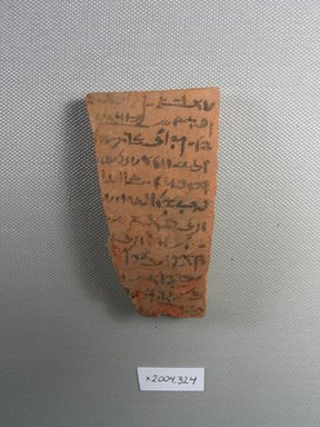 Demotic. <em>Demotic Ostracon</em>. Terracotta, pigment, 1 15/16 x 7/16 x 3 7/16 in. (4.9 x 1.1 x 8.7 cm). Brooklyn Museum, Gift of Evangeline Wilbour Blashfield, Theodora Wilbour, and Victor Wilbour honoring the wishes of their mother, Charlotte Beebe Wilbour, as a memorial to their father, Charles Edwin Wilbour, 16.580.541. Creative Commons-BY (Photo: Brooklyn Museum, CUR.16.580.541_view1.jpg)