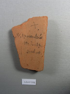Demotic. <em>Demotic Ostracon</em>, Year 13 (of Ptolemy II Philadelphus?). Terracotta, pigment, 2 3/16 x 7/16 x 3 1/2 in. (5.6 x 1.1 x 8.9 cm). Brooklyn Museum, Gift of Evangeline Wilbour Blashfield, Theodora Wilbour, and Victor Wilbour honoring the wishes of their mother, Charlotte Beebe Wilbour, as a memorial to their father, Charles Edwin Wilbour, 16.580.545. Creative Commons-BY (Photo: Brooklyn Museum, CUR.16.580.545_view1.jpg)