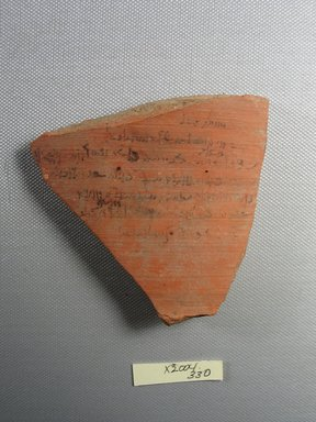 Demotic. <em>Demotic Ostracon</em>, Year 12 (?) of a Ptolemy. Terracotta, pigment, 3 9/16 x 3/8 x 3 9/16 in. (9 x 0.9 x 9 cm). Brooklyn Museum, Gift of Evangeline Wilbour Blashfield, Theodora Wilbour, and Victor Wilbour honoring the wishes of their mother, Charlotte Beebe Wilbour, as a memorial to their father, Charles Edwin Wilbour, 16.580.547. Creative Commons-BY (Photo: Brooklyn Museum, CUR.16.580.547_view1.jpg)