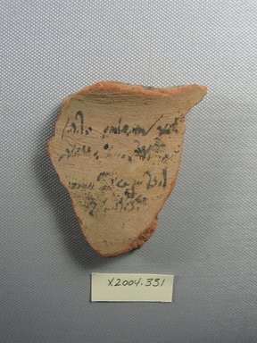 Demotic. <em>Demotic Ostracon</em>, Year 26 of Augustus or Tiberius?. Terracotta, pigment, 2 5/8 x 7/16 x 2 7/8 in. (6.6 x 1.1 x 7.3 cm). Brooklyn Museum, Gift of Evangeline Wilbour Blashfield, Theodora Wilbour, and Victor Wilbour honoring the wishes of their mother, Charlotte Beebe Wilbour, as a memorial to their father, Charles Edwin Wilbour, 16.580.548. Creative Commons-BY (Photo: Brooklyn Museum, CUR.16.580.548_view1.jpg)