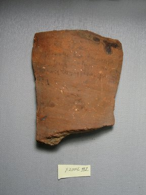 Demotic. <em>Demotic Ostracon</em>. Terracotta, pigment, 4 7/16 x 3/8 x 5 1/16 in. (11.3 x 1 x 12.9 cm). Brooklyn Museum, Gift of Evangeline Wilbour Blashfield, Theodora Wilbour, and Victor Wilbour honoring the wishes of their mother, Charlotte Beebe Wilbour, as a memorial to their father, Charles Edwin Wilbour, 16.580.549. Creative Commons-BY (Photo: Brooklyn Museum, CUR.16.580.549_view1.jpg)
