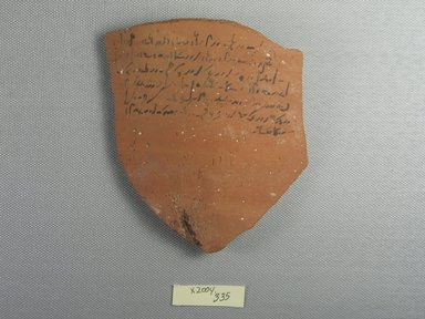 Demotic. <em>Demotic Ostracon</em>, Year 11 of Tiberius. Terracotta, pigment, 3 7/8 x 3/8 x 4 3/4 in. (9.8 x 0.9 x 12.1 cm). Brooklyn Museum, Gift of Evangeline Wilbour Blashfield, Theodora Wilbour, and Victor Wilbour honoring the wishes of their mother, Charlotte Beebe Wilbour, as a memorial to their father, Charles Edwin Wilbour, 16.580.552. Creative Commons-BY (Photo: Brooklyn Museum, CUR.16.580.552_view1.jpg)