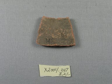 <em>Demotic Ostracon</em>. Terracotta, pigment, 1 7/16 x 1/4 x 1 7/8 in. (3.6 x 0.6 x 4.8 cm). Brooklyn Museum, Gift of Evangeline Wilbour Blashfield, Theodora Wilbour, and Victor Wilbour honoring the wishes of their mother, Charlotte Beebe Wilbour, as a memorial to their father, Charles Edwin Wilbour, 16.580.558. Creative Commons-BY (Photo: Brooklyn Museum, CUR.16.580.558_view1.jpg)