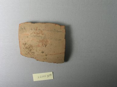 Demotic. <em>Demotic Ostracon</em>, Year 31 (of Ptolemy II Philadelphus). Terracotta, pigment, 3 1/4 x 1/2 x 2 3/4 in. (8.3 x 1.3 x 7 cm). Brooklyn Museum, Gift of Evangeline Wilbour Blashfield, Theodora Wilbour, and Victor Wilbour honoring the wishes of their mother, Charlotte Beebe Wilbour, as a memorial to their father, Charles Edwin Wilbour, 16.580.562. Creative Commons-BY (Photo: Brooklyn Museum, CUR.16.580.562_view1.jpg)