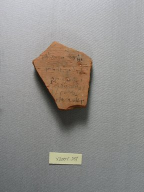 Demotic. <em>Demotic Ostracon</em>, Year 35 (of Ptolemy II Philadelphus). Terracotta, pigment, 2 5/8 x 1/2 x 3 1/16 in. (6.6 x 1.3 x 7.7 cm). Brooklyn Museum, Gift of Evangeline Wilbour Blashfield, Theodora Wilbour, and Victor Wilbour honoring the wishes of their mother, Charlotte Beebe Wilbour, as a memorial to their father, Charles Edwin Wilbour, 16.580.563. Creative Commons-BY (Photo: Brooklyn Museum, CUR.16.580.563_view1.jpg)