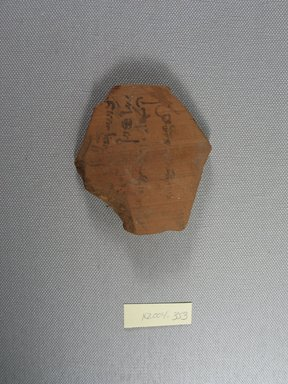 Demotic. <em>Demotic Ostracon</em>, Year 26 (?) of Augustus. Terracotta, pigment, 2 13/16 x 3/8 x 3 1/16 in. (7.1 x 0.9 x 7.7 cm). Brooklyn Museum, Gift of Evangeline Wilbour Blashfield, Theodora Wilbour, and Victor Wilbour honoring the wishes of their mother, Charlotte Beebe Wilbour, as a memorial to their father, Charles Edwin Wilbour, 16.580.565. Creative Commons-BY (Photo: Brooklyn Museum, CUR.16.580.565_view1.jpg)