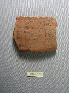 Demotic. <em>Demotic Ostracon</em>. Terracotta, pigment, 2 7/8 x 1/2 x 3 3/4 in. (7.3 x 1.3 x 9.6 cm). Brooklyn Museum, Gift of Evangeline Wilbour Blashfield, Theodora Wilbour, and Victor Wilbour honoring the wishes of their mother, Charlotte Beebe Wilbour, as a memorial to their father, Charles Edwin Wilbour, 16.580.567. Creative Commons-BY (Photo: Brooklyn Museum, CUR.16.580.567_view1.jpg)