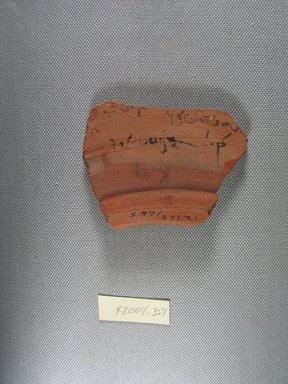 Demotic. <em>Demotic Ostracon</em>, Year 9 of a late ? Ptolemy. Terracotta, pigment, 2 1/2 x 9/16 x 3 1/4 in. (6.4 x 1.5 x 8.3 cm). Brooklyn Museum, Gift of Evangeline Wilbour Blashfield, Theodora Wilbour, and Victor Wilbour honoring the wishes of their mother, Charlotte Beebe Wilbour, as a memorial to their father, Charles Edwin Wilbour, 16.580.568. Creative Commons-BY (Photo: Brooklyn Museum, CUR.16.580.568_view1.jpg)