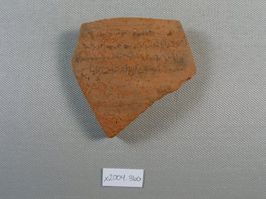 Demotic. <em>Demotic Ostracon</em>, Year 43 of Augustus. Terracotta, pigment, 2 13/16 x 1/4 x 3 1/16 in. (7.2 x 0.7 x 7.7 cm). Brooklyn Museum, Gift of Evangeline Wilbour Blashfield, Theodora Wilbour, and Victor Wilbour honoring the wishes of their mother, Charlotte Beebe Wilbour, as a memorial to their father, Charles Edwin Wilbour, 16.580.571. Creative Commons-BY (Photo: Brooklyn Museum, CUR.16.580.571_view1.jpg)