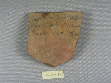 Demotic. <em>Demotic Ostracon</em>, Year 27 of Augustus. Terracotta, pigment, 3 9/16 x 7/16 x 3 15/16 in. (9 x 1.1 x 10 cm). Brooklyn Museum, Gift of Evangeline Wilbour Blashfield, Theodora Wilbour, and Victor Wilbour honoring the wishes of their mother, Charlotte Beebe Wilbour, as a memorial to their father, Charles Edwin Wilbour, 16.580.574. Creative Commons-BY (Photo: Brooklyn Museum, CUR.16.580.574_view1.jpg)