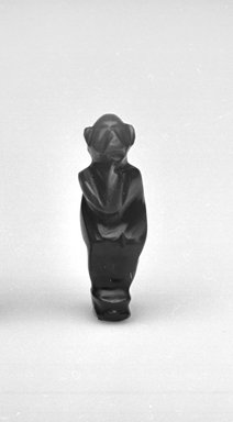 <em>Amulet in Form of Seated Monkey</em>. Carnelian, Height: 1 1/16 in. (2.8 cm). Brooklyn Museum, Gift of Evangeline Wilbour Blashfield, Theodora Wilbour, and Victor Wilbour honoring the wishes of their mother, Charlotte Beebe Wilbour, as a memorial to their father, Charles Edwin Wilbour, 16.580.57. Creative Commons-BY (Photo: Brooklyn Museum, CUR.16.580.57_05.370_GRPA_cropped_bw.jpg)