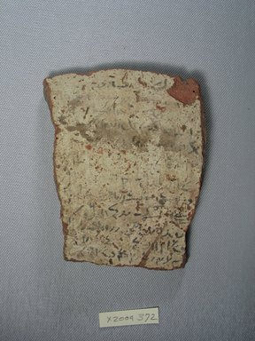 Demotic. <em>Demotic Ostracon</em>, Year 51 of Ptolemy VII Euergetes II. Terracotta, pigment, 4 x 3/8 x 5 in. (10.2 x 1 x 12.7 cm). Brooklyn Museum, Gift of Evangeline Wilbour Blashfield, Theodora Wilbour, and Victor Wilbour honoring the wishes of their mother, Charlotte Beebe Wilbour, as a memorial to their father, Charles Edwin Wilbour, 16.580.583. Creative Commons-BY (Photo: Brooklyn Museum, CUR.16.580.583_view1.jpg)