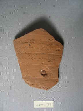 Demotic. <em>Demotic Ostracon</em>, Year 11 of Tiberius?. Terracotta, pigment, 3 7/8 x 3/8 x 4 5/8 in. (9.9 x 0.9 x 11.7 cm). Brooklyn Museum, Gift of Evangeline Wilbour Blashfield, Theodora Wilbour, and Victor Wilbour honoring the wishes of their mother, Charlotte Beebe Wilbour, as a memorial to their father, Charles Edwin Wilbour, 16.580.584. Creative Commons-BY (Photo: Brooklyn Museum, CUR.16.580.584_view1.jpg)