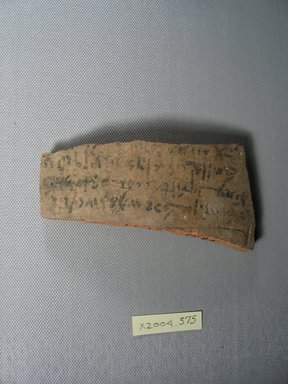 Demotic. <em>Demotic Ostracon</em>. Terracotta, pigment, 2 5/16 x 3/8 x 4 1/2 in. (5.9 x 1 x 11.5 cm). Brooklyn Museum, Gift of Evangeline Wilbour Blashfield, Theodora Wilbour, and Victor Wilbour honoring the wishes of their mother, Charlotte Beebe Wilbour, as a memorial to their father, Charles Edwin Wilbour, 16.580.586. Creative Commons-BY (Photo: Brooklyn Museum, CUR.16.580.586_view1.jpg)