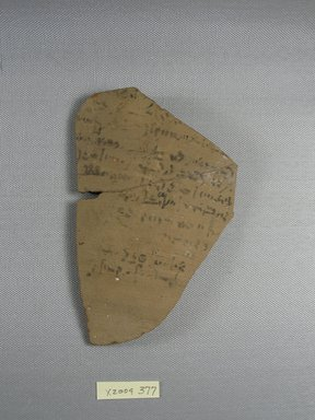 Demotic. <em>Demotic Ostracon</em>, Year 10 (of a late (?) Ptolemy). Terracotta, pigment, 3 13/16 x 1/4 x 6 in. (9.7 x 0.6 x 15.2 cm). Brooklyn Museum, Gift of Evangeline Wilbour Blashfield, Theodora Wilbour, and Victor Wilbour honoring the wishes of their mother, Charlotte Beebe Wilbour, as a memorial to their father, Charles Edwin Wilbour, 16.580.588. Creative Commons-BY (Photo: Brooklyn Museum, CUR.16.580.588_view1.jpg)