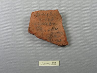 Demotic. <em>Demotic Ostracon</em>. Terracotta, pigment, 2 9/16 x 3/8 x 2 9/16 in. (6.5 x 1 x 6.5 cm). Brooklyn Museum, Gift of Evangeline Wilbour Blashfield, Theodora Wilbour, and Victor Wilbour honoring the wishes of their mother, Charlotte Beebe Wilbour, as a memorial to their father, Charles Edwin Wilbour, 16.580.589. Creative Commons-BY (Photo: Brooklyn Museum, CUR.16.580.589_view1.jpg)