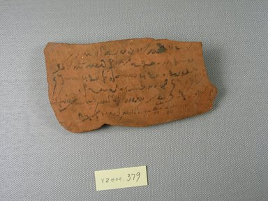 Demotic. <em>Demotic Ostracon</em>, Year 2 of Tiberius. Terracotta, pigment, 2 11/16 x 1/4 x 4 13/16 in. (6.9 x 0.7 x 12.3 cm). Brooklyn Museum, Gift of Evangeline Wilbour Blashfield, Theodora Wilbour, and Victor Wilbour honoring the wishes of their mother, Charlotte Beebe Wilbour, as a memorial to their father, Charles Edwin Wilbour, 16.580.590. Creative Commons-BY (Photo: Brooklyn Museum, CUR.16.580.590_view1.jpg)