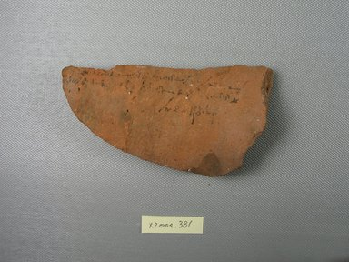 Demotic. <em>Demotic Ostracon</em>, Year 39 of Augustus. Terracotta, pigment, 2 9/16 x 1/2 x 4 3/4 in. (6.5 x 1.3 x 12.1 cm). Brooklyn Museum, Gift of Evangeline Wilbour Blashfield, Theodora Wilbour, and Victor Wilbour honoring the wishes of their mother, Charlotte Beebe Wilbour, as a memorial to their father, Charles Edwin Wilbour, 16.580.592. Creative Commons-BY (Photo: Brooklyn Museum, CUR.16.580.592_view1.jpg)