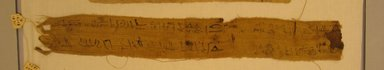 <em>Mummy Bandage</em>, 332 B.C.E.-1st century C.E. Linen, ink, 2 9/16 x 14 3/4 in. (6.5 x 37.5 cm). Brooklyn Museum, Gift of Evangeline Wilbour Blashfield, Theodora Wilbour, and Victor Wilbour honoring the wishes of their mother, Charlotte Beebe Wilbour, as a memorial to their father, Charles Edwin Wilbour, 16.580.608 (Photo: Brooklyn Museum, CUR.16.580.608_view1.jpg)