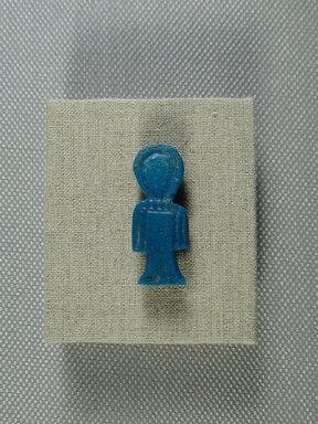 <em>Isis-knot Amulet</em>, 664–332 B.C.E. Faience, 1 1/8 x 7/16 x 3/16 in. (2.9 x 1.1 x 0.5 cm). Brooklyn Museum, Gift of Evangeline Wilbour Blashfield, Theodora Wilbour, and Victor Wilbour honoring the wishes of their mother, Charlotte Beebe Wilbour, as a memorial to their father Charles Edwin Wilbour, 16.580.65. Creative Commons-BY (Photo: Brooklyn Museum, CUR.16.580.65.jpg)