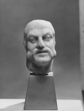 Roman. <em>Male Head</em>, 3rd century C.E. probably. Marble, 3 1/4 x 2 1/16 x 2 7/16 in. (8.2 x 5.3 x 6.2 cm). Brooklyn Museum, Gift of Evangeline Wilbour Blashfield, Theodora Wilbour, and Victor Wilbour honoring the wishes of their mother, Charlotte Beebe Wilbour, as a memorial to their father, Charles Edwin Wilbour, 16.580.78. Creative Commons-BY (Photo: Brooklyn Museum, CUR.16.580.78_NegA_print_bw.jpg)