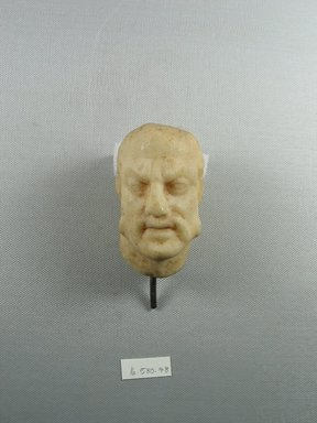 Roman. <em>Male Head</em>, 3rd century C.E. probably. Marble, 3 1/4 x 2 1/16 x 2 7/16 in. (8.2 x 5.3 x 6.2 cm). Brooklyn Museum, Gift of Evangeline Wilbour Blashfield, Theodora Wilbour, and Victor Wilbour honoring the wishes of their mother, Charlotte Beebe Wilbour, as a memorial to their father, Charles Edwin Wilbour, 16.580.78. Creative Commons-BY (Photo: Brooklyn Museum, CUR.16.580.78_view1.jpg)