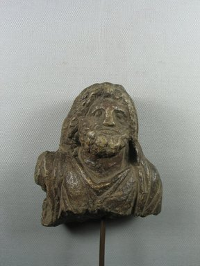 Graeco-Egyptian. <em>Head and Bust of Serapis</em>, 2nd-4th century C.E. (probably). Steatite, 5 11/16 x 4 9/16 x 2 1/2 in. (14.4 x 11.6 x 6.3 cm). Brooklyn Museum, Gift of Evangeline Wilbour Blashfield, Theodora Wilbour, and Victor Wilbour honoring the wishes of their mother, Charlotte Beebe Wilbour, as a memorial to their father, Charles Edwin Wilbour, 16.580.79. Creative Commons-BY (Photo: Brooklyn Museum, CUR.16.580.79_view1.jpg)