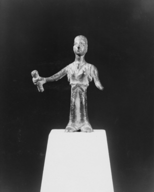 Etruscan. <em>Statuette of a Standing Woman</em>. Bronze, 2 5/8 x 1 7/8 in. (6.7 x 4.8 cm). Brooklyn Museum, Gift of Evangeline Wilbour Blashfield, Theodora Wilbour, and Victor Wilbour honoring the wishes of their mother, Charlotte Beebe Wilbour, as a memorial to their father, Charles Edwin Wilbour, 16.580.85. Creative Commons-BY (Photo: Brooklyn Museum, CUR.16.580.85_NegA_print_bw.jpg)
