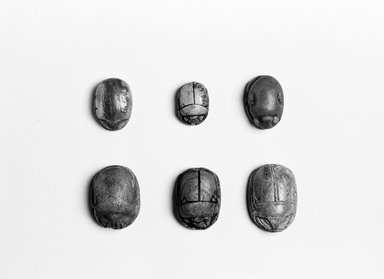 <em>Scarab</em>, ca. 1352-1336 B.C.E. Steatite, 9/16in. (1.4cm). Brooklyn Museum, Gift of the Egypt Exploration Society, 25.886.3. Creative Commons-BY (Photo: , CUR.16.598_16.609_25.886.3_16.584_16.423_35.1115_neg_16.598_grpA_bw.jpg)